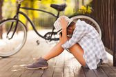 Sad young woman sitting at the park — Stock Photo