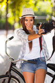 Young woman taking self portrait outdoors — Stock Photo