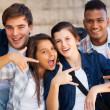 Group of teenagers giving cool hand signs — Stock Photo