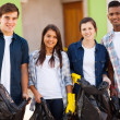 Stock Photo: Teenage volunteers with garbage bag