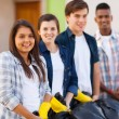 Teenage volunteers standing with waste bags — Stock Photo