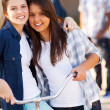 Stock Photo: Two teen girls friends hugging
