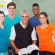 Stock Photo: High school students in classroom with senior teacher