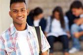 Indian teenage student carrying schoolbag — Stock Photo