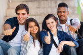 High school students giving thumbs up — Stock Photo