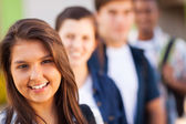 Teenage high school girl with friends — Stock Photo