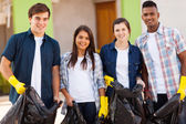 Teenage volunteers with garbage bag — Stock Photo