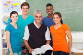 High school students in classroom with senior teacher — Stock Photo