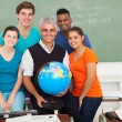 Stock Photo: Male teacher holding a globe