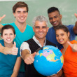 High school students and senior teacher giving thumbs up — Stock Photo #26791573