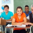 High school teacher with group of students — Stock Photo