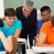 Senior high school teacher helping students — Stock Photo