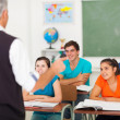 High school teacher teaching students — Stock Photo #26794893