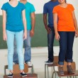 Group of high school students standing on desks — Stock Photo