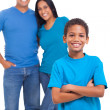 Young boy standing in front of parents — Stock Photo