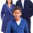 Young boy in nightgown standing in front of parents — Stock Photo #26799913