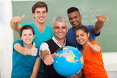 High school students and senior teacher giving thumbs up — Stock Photo