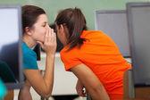 High school girls gossiping in class — Stock Photo