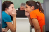 Cute high school students gossiping — Stock Photo