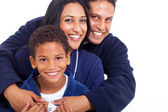 Young indian family in pajamas hugging — Stock Photo