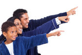 Indian family in nightclothes pointing empty copy space — Stock Photo