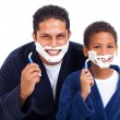 Playful little boy shaving with father — Stock Photo