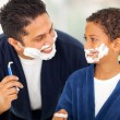 Playful father and son shaving together — Stock Photo #26800071