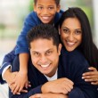 Adorable indian family pyramid on bed — Stock Photo