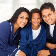 Stock Photo: Cute indian family sitting on bed