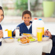 Happy indian fmaily having breakfast — Stock Photo