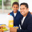Father and son at breakfast table — Stock Photo