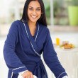 Indian woman ironing clothes — Stock Photo