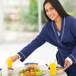 Indian woman preparing breakfast for family — Stock Photo