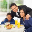 Stock Photo: Indian man and family before leaving for work