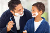 Playful father and son shaving together — Stock Photo