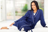 Indian woman in nighclothes relaxing on bed — Stock Photo