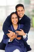 Happy indian couple hugging on bed — Stock Photo