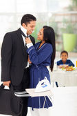 Loving wife helping husband with his tie — Stock Photo