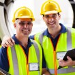 Shipping company inspectors standing in between industrial tires — Foto Stock