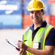 Young shipping company worker at harbor container depot — Stock Photo