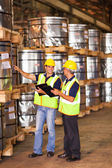 Shipping company workers counting pallets — Stock Photo
