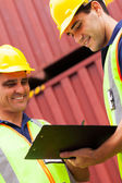 Harbor workers recording containers — Stock Photo