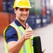 Container warehouse worker giving thumb up — Stock Photo
