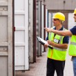 Stock Photo: Warehouse workers checking open containers