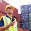 Middle aged warehouse worker holding radio — Stock Photo