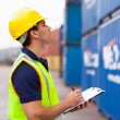 Stock Photo: Warehouse worker recording containers