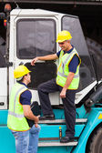 Forklift driver talking to co-worker — Stock Photo