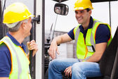 Warehouse co-workers chatting during break — Stock Photo