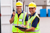 Senior warehouse worker and colleague — Stock Photo