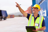 Shipping company worker at container depot — Stock Photo